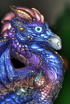 Melody Peñ  (I was so enamored of these dragons when I was in my late teens.  They were way more expensive than my 18 year old self could afford, so I'd go visit them in the mall kiosk.  My aesthetic as since evolved, but they bring back memories. ~ZR~ )