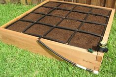 Drip Watering System that also defines the Square Foot Gardening. Awesome!