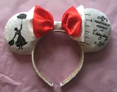 Black and white Mary poppins ears with a red and white satin bow.
