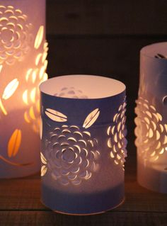 DIY: Dimensional Paper Lantern. 3-dimensional blossom lanterns / candle holders are made from 3 things everyone has – old drinking glasses or vases, paper, and candles