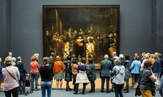 Flashmob recreates Rembrandt's painting, The Night Watch, in a shopping centre in Breda to coincide with the painting's return to the Rijksmuseum in Amsterdam