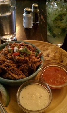 Pernil lunch size with a delicious Mojito! Puerto Rican cuisine.