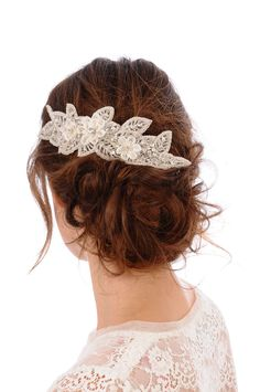 I really want this, but it's ridiculously over priced.   Jennifer  Lux Headpiece -  bridal comb, rhinestone, crystal, veil, brooch, headpiece, Swarovski. $428.00, via Etsy.