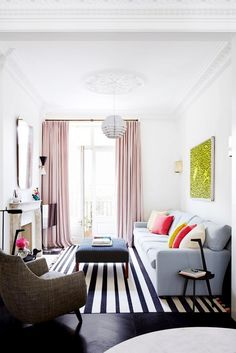 A bright living room with graphic elements