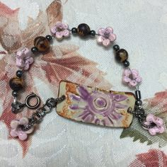 ABS NOV - Bracelet made with seeds Bohemian Pink Flower with ceramic artisan focal by Suzieqbeads and flowers by Mudaliscious