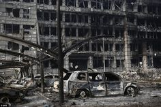 Grim scenes show burnt-out vehicles and a building which was completely gutted in the blasts on Wednesday