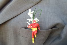 Showcase a fun hobby or favorite thing as a wedding accessory like this superhero inspired by AlwaysElegentBridal #boutonniere