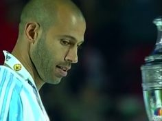 Mascherano  glances at the Copa America during the awards ceremony after the final match. CA  4.7.15