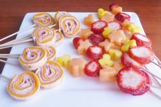 pinwheel wraps and fruit skewers  look good? learn how!  http://www.queensmamas.com/queens_mamas/2012/05/party-food-recipes-for-kids.html#