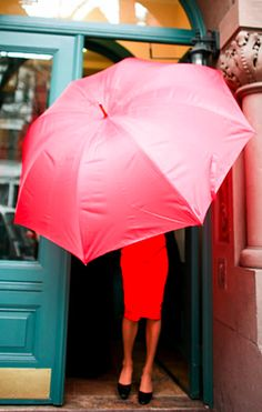 red pencil skirt. pink umbrella.