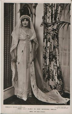 Actress Lily Elise showing off her fabulous wedding gown, ca late edwardian.