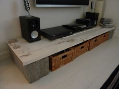 TV table made of old door and two concrete blocks.