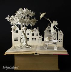 Items similar to Listen To The Wind Blow - Book Arts - Book Sculpture - Altered Book on Etsy Book Crafts, Paper Crafts, Altered Book Art, Deco Floral, Spanish Artists, Book Projects, Clay Projects, Harvest Moon, Book Folding