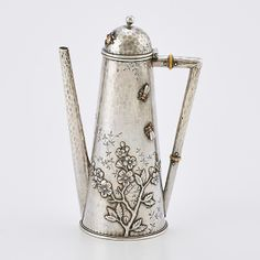 """JAPANESQUE STERLING AND MIXED METAL COFFEE POT; Whiting tapered cylindrical form with dome lid, spot-hammered and foliate chased, embellished with applied beetle, flies and a spider above blossoming cherry bough, ivory insulators, ca. 1880; Marked sterling 779E; 7 1/2""""; 10.83 OT. Note: While this example is not marked Whiting, the same model, fully marked, was sold in Texas, 2004"""