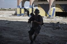 https://flic.kr/p/zoMuzv | Sirio Timossi in action photo by A. Romenzi | Lighting cameraman and war reporter Sirio Timossi in action.  Benghazi, Libya, 2015. Photo by Alessio Romenzi.
