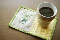 Elegantly Embroidered Mug Rug has great link for binding.