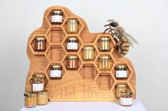 This custom wood honey display is so neat! Perfect for a farmer's market display!