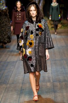 """""""Enchanted Sicily"""" was the title Dolce & Gabbana gave their collection, but what we saw was actually a timely departure from the overtly folkloric tone of the duo's recent collections. For all the arcana of their inspiration, the clothes themselves managed to build a bridge to the real world."""