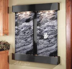 The Cottonwood Falls wall mounted water feature is a classic looking wall fountain. With three panels this large water wall is perfect for your office.
