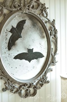 Make a vintage-inspired Halloween mirror with spray paint and plastic cling wrap….