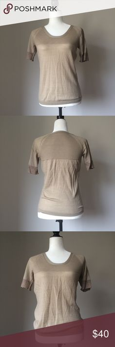 """Boss Hugo Boss crew tshirt I loved this t-shirt, but no longer fits me well. ❗️There are 2 small pulled threads on the lower back, that I have tried to capture in last pics❗️23"""" long, waist flat across 16,5"""". Details on sleeves, desiner gold logo, very feminine and easy to pair with trousers or skirts, or simply jeans. Hugo Boss Tops Tees - Short Sleeve"""