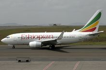 Ethiopian Airlines Boeing 737–700 on the Bole International Airport runway.