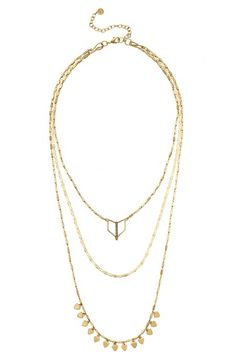 The shiny gold Terra Layering Necklace has sparkly black diamonds that stand out in the crowd. Shop versatile layering necklaces at Stella & Dot.