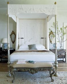 four-poster by John Robshaw Textiles is topped with a canopy embroidered by Ankasa in bedroom by Michael S. Smith.