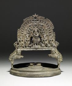 A lamp, with a flat, stepped, circular base and a fan-shape, vertical upper area decorated with figures, once with a ring for suspension (now lost). On one side of this fan-shaped projection is a fluting Krishna and on the other Gaja Lak?mi with attendants. Brass Lamp, Brass Metal, Indian Lamps, Buddhist Shrine, Ganesh Statue, Antique Oil Lamps, Vintage India, Indian Artifacts, Pooja Rooms
