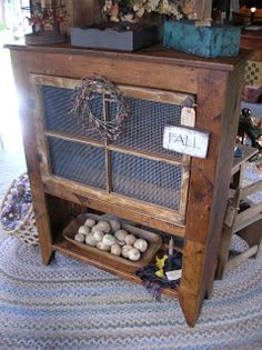 Cupboard made from old pine boards, chicken wire, and an old window. How cool would this look in a country kitchen or how full of antiques!?