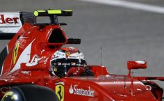 Scuderia Ferrari Finnish driver Kimi Raikkonen drives during the Formula One Bahrain Grand Prix at the Sakhir circuit in the desert south of the Bahraini capital, Manama, on April 19, 2015.