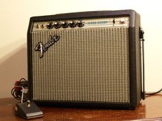 1980 Silverface Fender Vibro Champ. Funny thing about these amps is that they sound surprisingly nice, considering they were made from the cheapest materials on the planet. Fender was so cheap, the baffles on these amps were held on with VELCRO. That's right. Frickin velcro. I guess it's a good idea if you need to take the baffle off a lot (for some weird reason), but the velcro comes off after 30 years of stickiness.