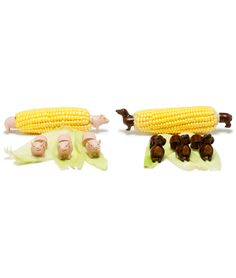 From Head To Tail  Corn on the cob is all dressed up with nowhere to go but on a plate of yummy barbecue. At last, a favorite cookout food finds the perfect holder. The cute piggies aren't a statement on your table manners, but a clever way to keep fingers clean, while the original weenie dog finds itself in a familiar shape nestled next to a hot dog. Dishwasher safe with stainless steel prongs, these fun holders will soon become a backyard party staple. Made in China.