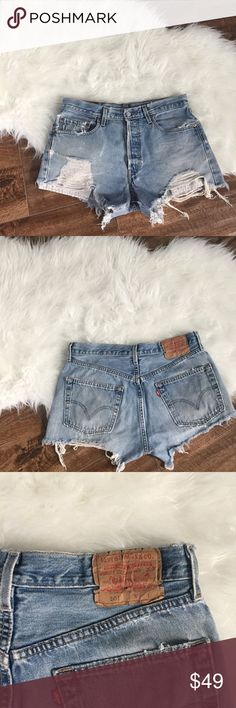 """Vintage Levi 501 jean shorts Levi 501 vintage denim shorts. Distressed throughout. Some blue paint marks throughout. Button fly. Distressed on the crotch area. Measurements: waist 16.5"""" laying flat, inseam 4"""", length 12"""" on the longest part. Levi's Shorts Jean Shorts"""