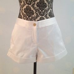 White Satin Shorts White Satin shorts. 97% polyester/3% spandex. Gold buttons and side waist clasp. Front and back pockets. Express Design Studio Shorts