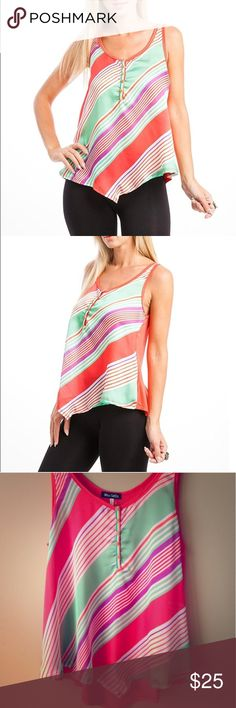 "Chic women's chic neon stripe Hi-Lo top Retro inspires, this sleeveless stripe printed button high low tank is great for a hot day, solid colored back and a scoop neckline make sure to keep this shirt from being too ""loud"". It is brand new and has never been worn before. It has no damage to it and is flawless!!! I bundle as well!! Let me know if you have any questions!! Tops Blouses"