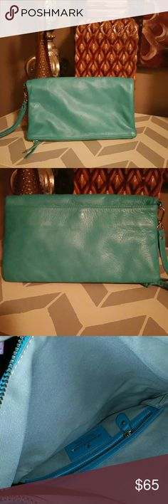 """Alberta Di Canio Turquoise Clutch """"BUTTER SOFT"""" is how i would describe this beauty. Perfect pop of turquoise color to add to your out fit. This bag is in perfect 👌 condition absolutely no wear. Has a huge inner and outer pocket. Made in Italy Alberta Di Canio Bags Clutches & Wristlets"""