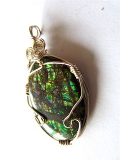 Ammolite Pendant with Green, Violet, and Yellowish Orange Fire. $115.00, via Etsy.