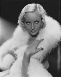 "Carole Lombard. ""I live by a man's code, designed to fit a man's world, yet at the same time I never forget that a woman's first job is to choose the right shade of lipstick."""