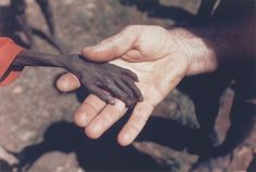 1980 A starving boy and a missionary in Uganda. (Mike Wells)