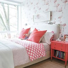 Flamingo wallpaper, neutrals and coral bedside table. So cute.