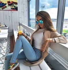 white halter, camel colored sweater, light skinny jeans...