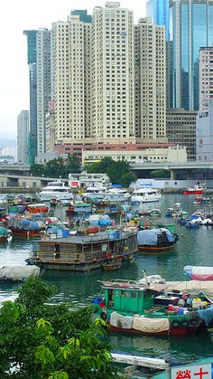 The typhoon shelter of Causeway Bay, Hong Kong, is right next to some of the city's glitziest shopping malls and skyscrapers, yet it houses some traditional boats...
