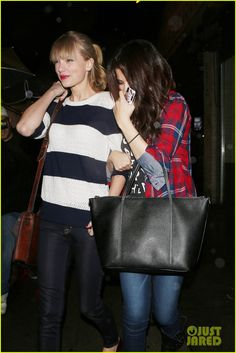 : Photo Selena Gomez tries to hide behind her BFF Taylor Swift as they head into Osteria La Buca for dinner on Saturday night (November in Los Angeles. Beautiful Taylor Swift, Taylor Swift Style, Taylor Alison Swift, Selena Gomez, Nashville, Selena And Taylor, Diamonds In The Sky, Best Friends Forever, Celebrity Crush