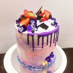 One seriously tall bad boy rolled out for Wendy's birthday! Pomegranate molasses soaked chocolate cake with pomegranate buttercream filling. Swirls of pinks and purples with a deep purple drip and a looooooot of violas!