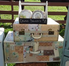 scrapbook and vintage papers decorate vintage suitcases - By Home Sweet Nest