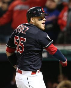 Cleveland Indians Roberto Perez is pump up as he heads to the dugout after hitting a 3 run homer in the 8th inning to put the Indians up 6-0 over the Chicago Cubs in Game 1 of the World Series against the at Progressive Field, in Cleveland, Ohio on Oct. 25, 2016. (Chuck Crow/The Plain Dealer)
