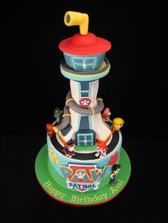 Another Paw Patrol cake with edible tower. After seeing last week's Paw Patrol cake, my customer asked for a late change to have her cake made the same. A tower made from rice bubbles and marshmallow was covered in fondant and sits on a chocolate mud cake. All the figurines are handmade from fondant too. www.facebook.com/cakesbyleannerhodes