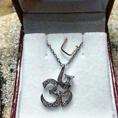 Diamonds and gold, OM pendant