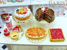 Red fruit treats, fruity cream tart, chocolate cheesecake, apricot tart, cherry tart.  Average diameter about 2cm (less than one inch!)